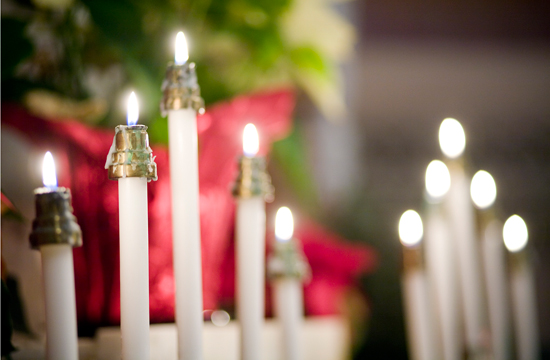 Candles light the Chapel at Christmas