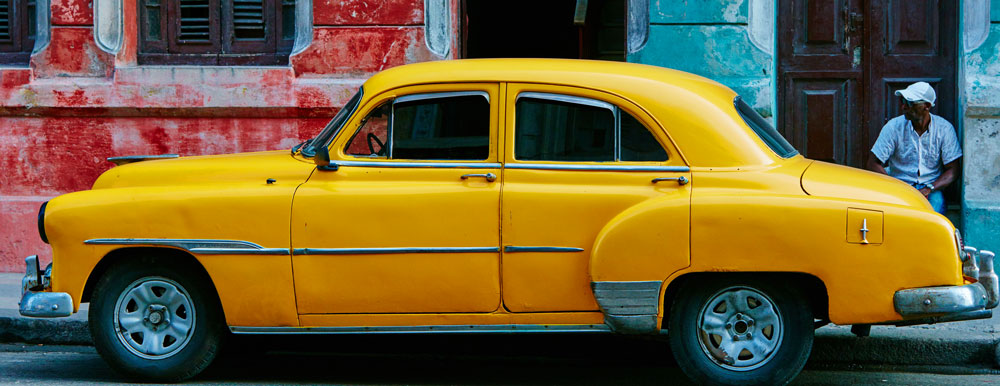 Yellow Vintage Car in Havana By Wolf Schram wolfbroadcast (http://unsplash.com/photos/19t6J2RVqQE) [CC0], via Wikimedia Commons
